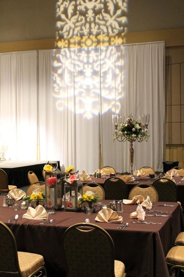 "43"" silver candelabra flanked tables around the dance floor."