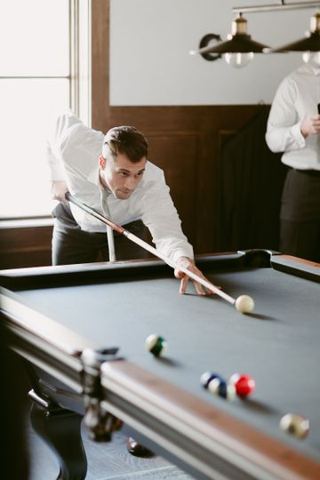 Groom playing billards - Blue Vinyl Creative