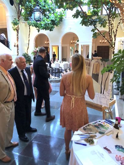 Guests interact with the artist throughout the event.