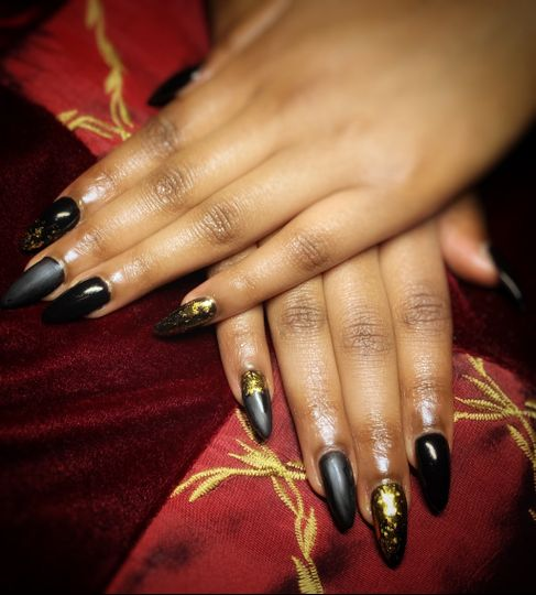 Long black nails with gold