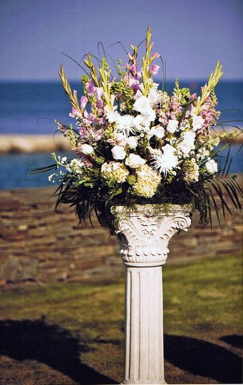 Classic arrangement on a pillar.  A pair marks the ceremony space.