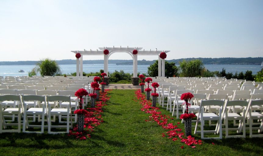 Roses, roses, roses!  Topiary balls on arbor, topiary forms and petals line the aisle - beautiful!