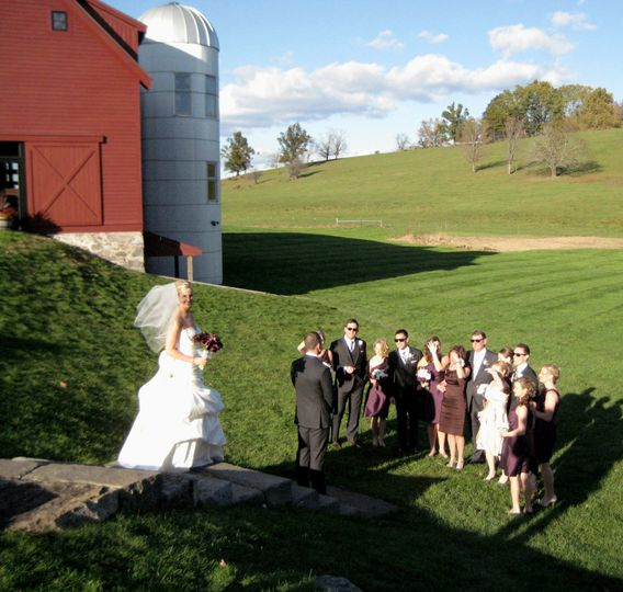 Beautiful historic barn and farmland makes a great backdrop to this wedding ceremony.
