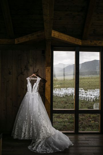 The dress hanging by the window