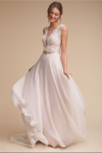 BHLDN Taryn Gown		Delicate lace traverses the bodice of this romantic gown, framing a dramatic...