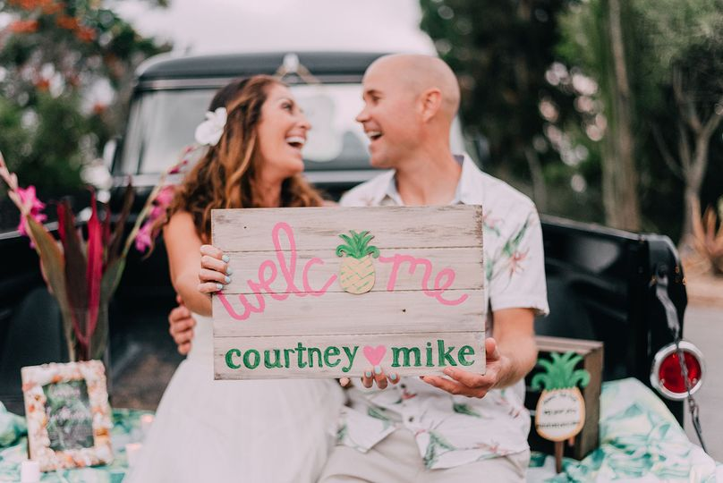 Couple photo with welcome sign