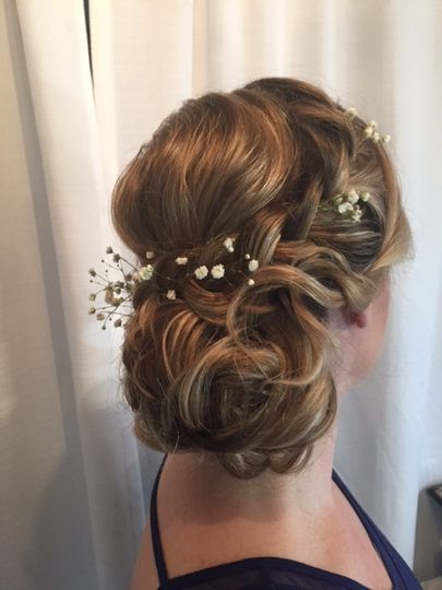 Wedding updo with little flowers