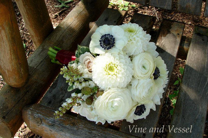 All white bouquet of dahlias, anemones, ranunculas, roses and andromeda by Vine & Vessel Inc.