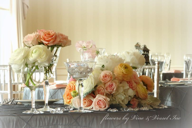 Romantic and elegant, this spring sweetheart table decor with vintage stemware and soft blooms...
