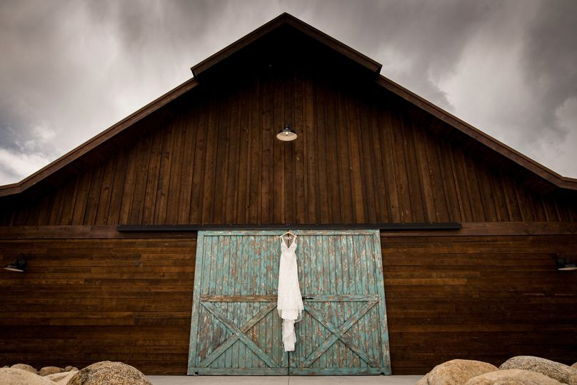 Dress hanging on barn doors