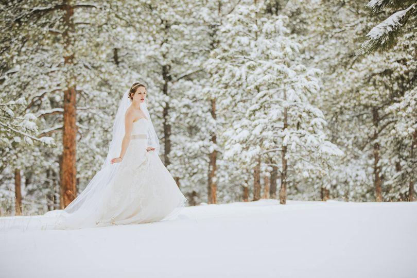 Bride walking through the snow