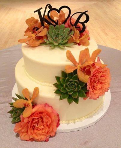 White wedding cake with orange flowers