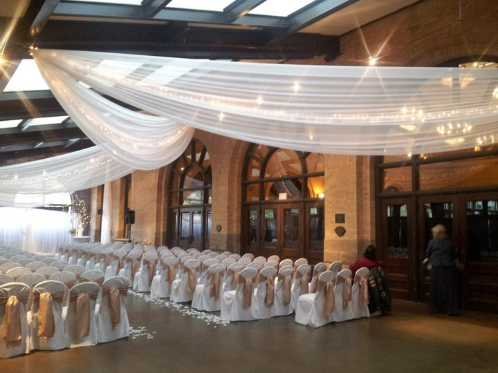 The Minneapolis Depot-Grand Designs provided ceiling drape, chair cover and sashes, and ceremony...