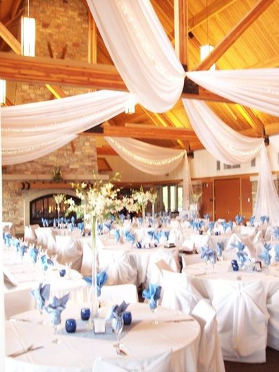 Elm Creek ChaletWe provided ceiling draping, linens, chair covers, and centerpieces.