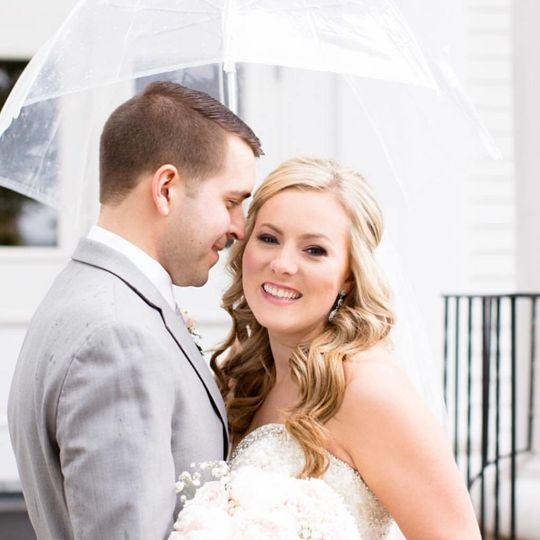 Couple underneath umbrella