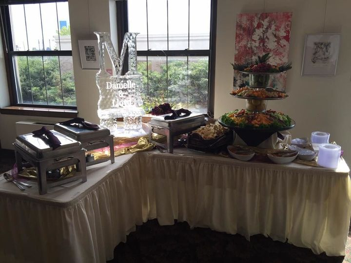 Hors d' oeuvres & ice sculpture