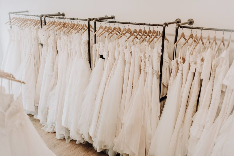 Browse our gowns, on the floor ready for you to spot your perfect gown! Photo by: KCM Studios
