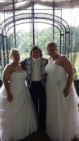 Officiant with newlyweds