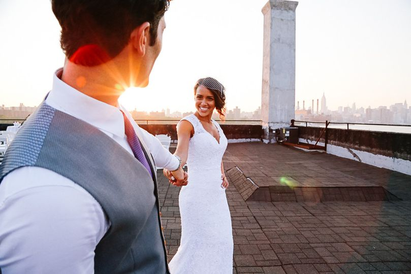 bride and groom at sunset.  Rooftop venue in brooklyn, new york