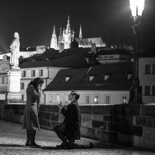 This is me proposing to my fiancé on the Charles Bridge in Prague. I set up my camera on a tripod...