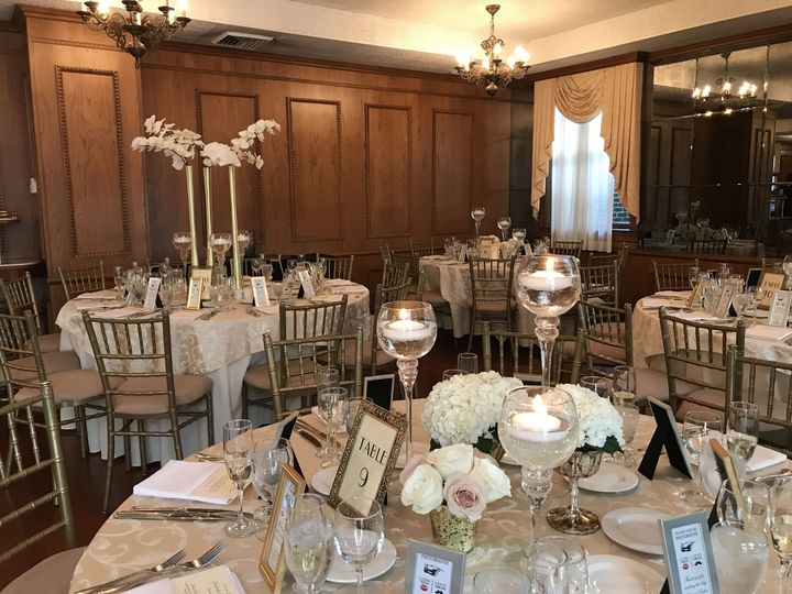 Beautiful florals and candle centerpieces at the De Seversky mansion