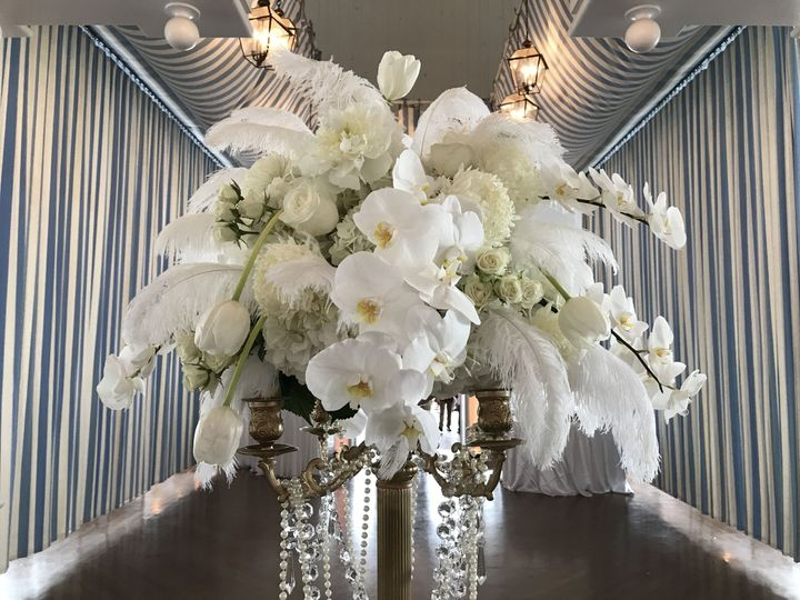 Stunning orchid and feather Gatsby style candelabra