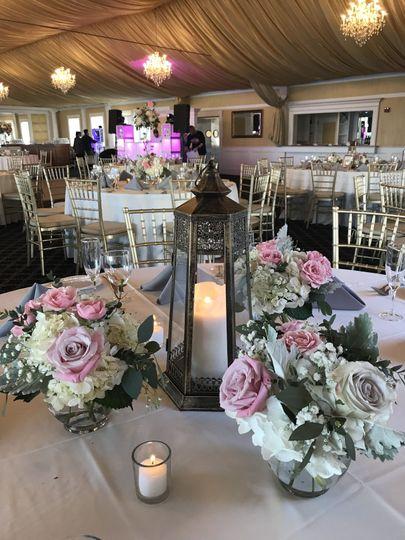 Rented lanterns with floral arrangements surrounding