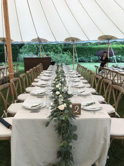 Eucalyptus table garlands at a backyard wedding in South Hampton