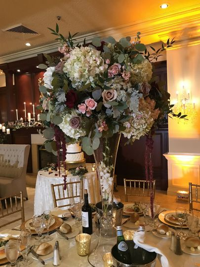 Tall and lush with greenery centerpieces in the Gable room at The Inn at New Hyde Park