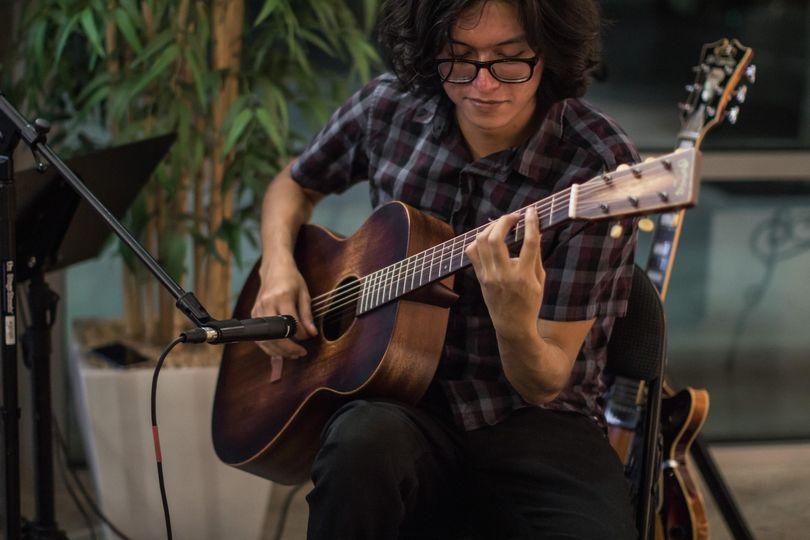 Luis on guitar