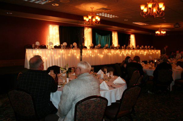 beautiful lifted head table with running skirt lighting
