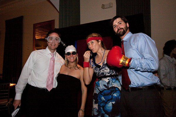 Guests hamming it up with props for the photobooth. Angela Gaeto Photography.