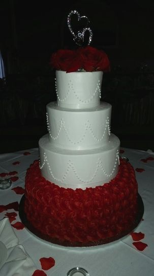 Wedding cake with red rosettes