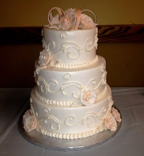 Traditional ivory on ivory wedding cake