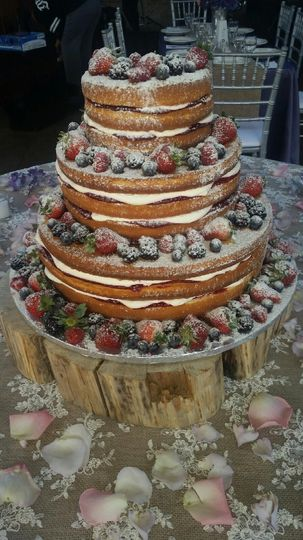 Naked wedding cake with fresh fruits