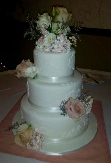 Fondant lace and flowers wedding cake