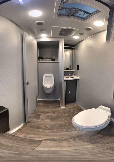 Men's room , quartz top, stainless sink, elegant soap & towel dispenser, urinal, mirror heat/AC,...