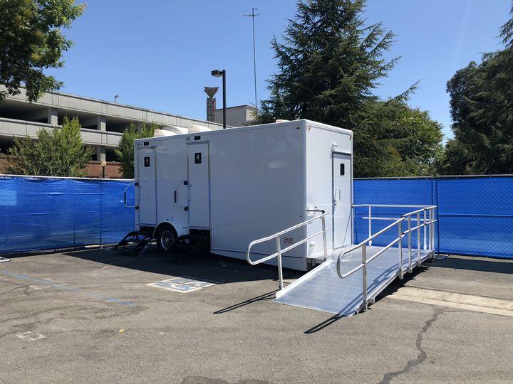 3 stall plus ADA / Bride Suite luxury restroom trailer in use at Modesto foam festival.