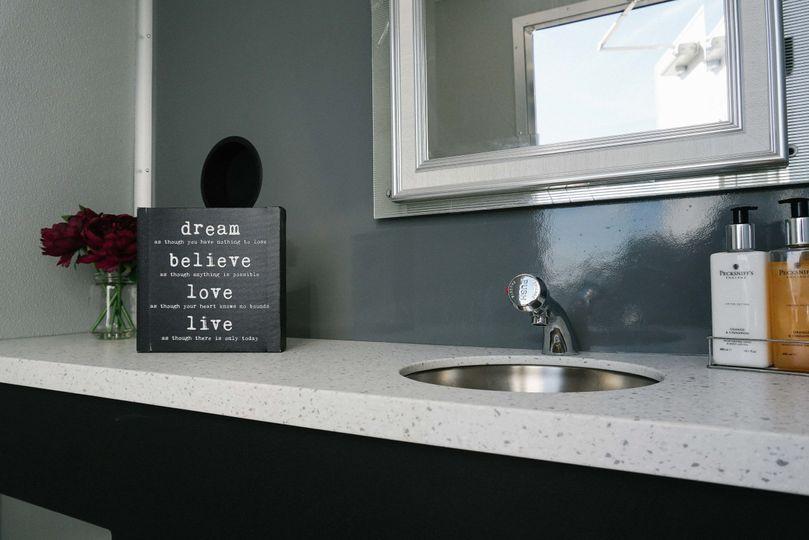 Beautiful grain countertop on all stalls on luxury restroom trailer.