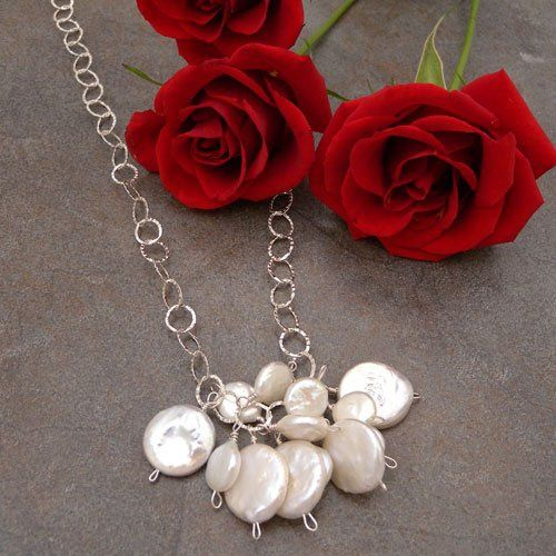 a profusion of multi sized coin pearls on a sterling silver chain.