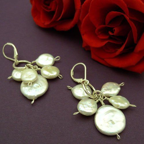 A profusion of coin pearls dangle from a sterling silver ring on sterling silver leverback earwires.