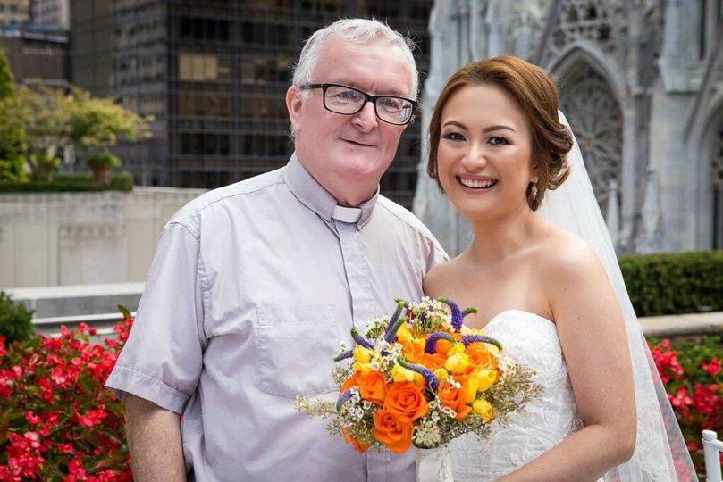 The bride with Fr. Noel