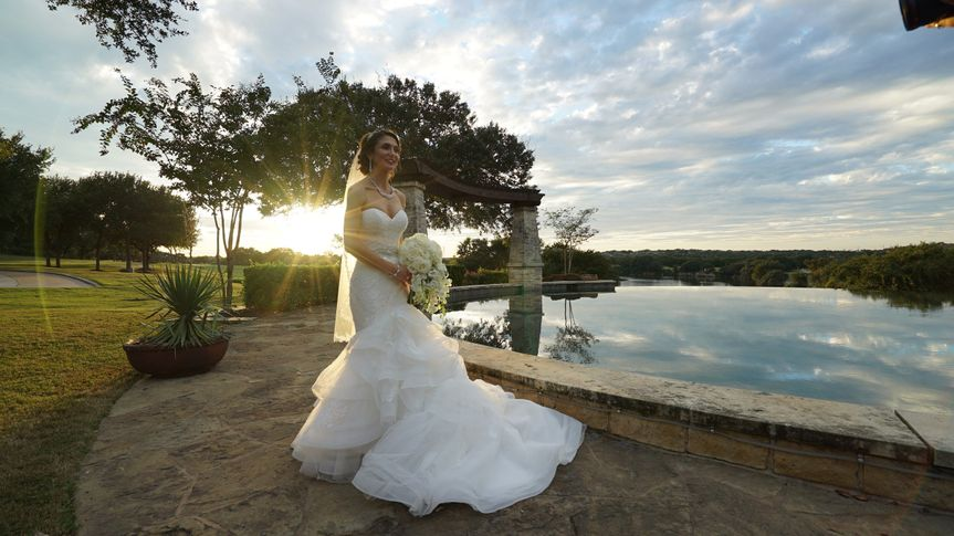 The beautiful Bride with the Avery Ranch reflection pond.