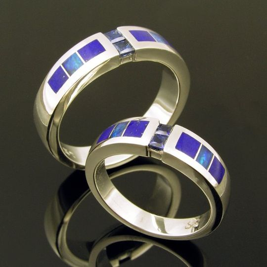 Australian opal and lapis wedding ring set with blue sapphires channel set in the center.  This...
