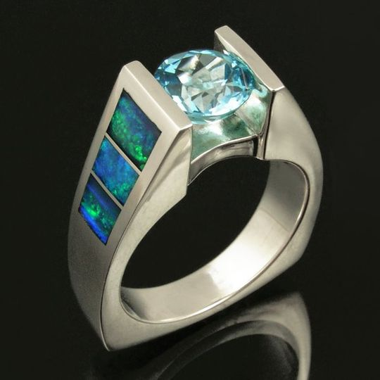 Sparkling blue topaz sterling silver ring inlaid with Australian opal. Round blue topaz is 7mm wide...