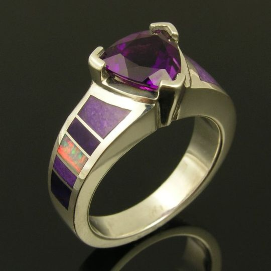 Sterling silver ring featuring a 1.6 carat Amethyst accented by Australian opal and sugilite inlay....