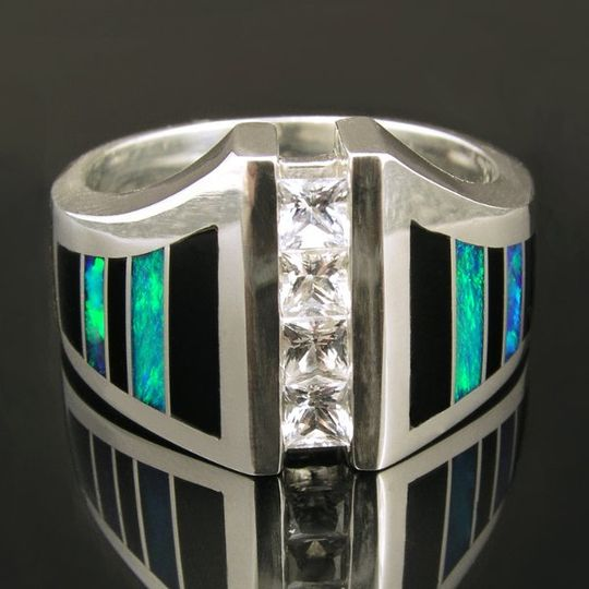 Striking sterling silver man's white sapphire ring inlaid with black onyx and Australian opal. Four...
