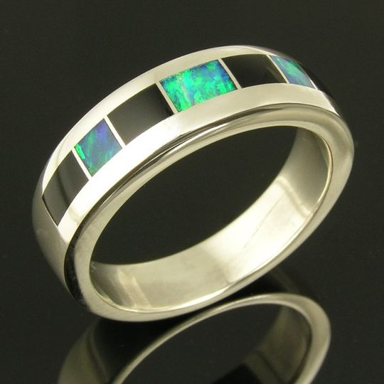 Sterling silver ring band inlaid with Australian opal and black onyx by Mark Hileman. The 3 pieces...