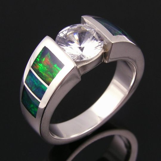 Australian opal wedding ring accented by white sapphire in sterling silver.  A sparkling 1.25ct....