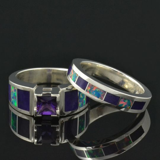 Amethyst engagement ring inlaid with purple sugilite and lab created opal in sterling silver.  The...